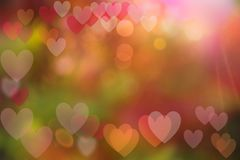 Festive background with bokeh heart-shaped, multi-colored. From the shine of natural light Royalty Free Stock Images