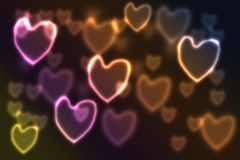 Festive background with bokeh heart-shaped, multi-colored. By neon lights Royalty Free Stock Photos