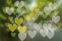 Festive background with bokeh heart-shaped, multi-colored. From the shine of natural light Stock Images