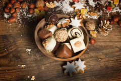 Festive background with candies, nuts,  on wooden table. Festive background with candies, nuts, cookies on wooden table Royalty Free Stock Images