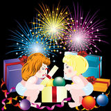 Festive background with children. Children with Christmas gifts on the background of fireworks Stock Photos