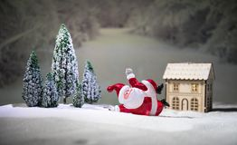 Festive background. Christmas decorations. Santa Claus (or Snowman) standing on snow with beautiful decorated background with. Holiday elements. Selective focus royalty free stock photos