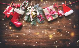 Festive background with Christmas presents, Santas accessories a. Nd decoration on the clothesline in front of wooden board. Top view royalty free stock photos
