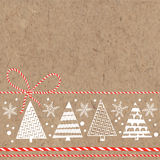 Festive background with Christmas trees and snowflakes on kraft. New Year or Christmas background. Vector illustration with Christmas trees and space for text on Royalty Free Stock Images