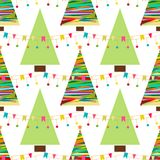 A festive background with confetti. A seamless pattern with yellow stars and Christmas tree. Winter holidays design.. A festive background with confetti. A Stock Image
