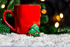 Festive background with a Cup of Tea and gingerbread tree on a snow stock photos
