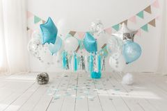 Festive background decoration for birthday celebration with gourmet cake and blue balloons in studio, cake smash first. Year concept stock photography