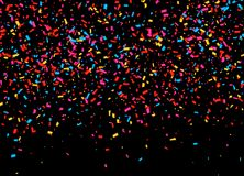 Festive background with falling confetti. Vector Stock Images