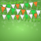 Festive background with flags. Colorful festive flags on green bokeh background. Irish holiday, celebration party. St. Patrick`s day greeting card. Vector Stock Photography