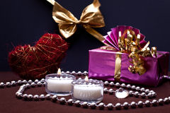 Festive background with gift and candles Stock Images