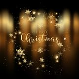 Decorative Christmas background with gold bokeh lights. Festive background of gold defocussed bokeh lights with decorative type, snowflakes and stars Stock Photo