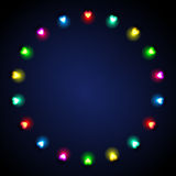 Festive background with heart-shaped lights. Festive stylish background with colored heart-shaped lights on dark blue textured background Stock Photo
