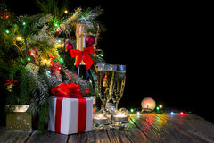 Festive background with lights and champagne,. Festive background with lights, champagne, bells and garlands Royalty Free Stock Photo