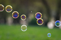 Festive background with lots of bright iridescent soap bubble wi royalty free stock image
