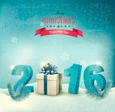 Festive background with 2016 numbers and a gift box. Royalty Free Stock Photo