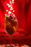Festive background with present boxes and hearts bokeh Stock Photography