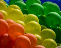 Festive background of blue green yellow organge and red baloons. Festive background of purple, blue and green baloons - large happy copyspace Stock Photography