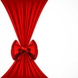 Festive background with red bow. The wide red ribbon and red bow on a white background Royalty Free Stock Photo