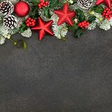 Festive Background with Red Star Baubles and Winter Flora