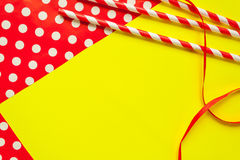 Festive background with Red and White striped straws and wrapping paper and ribbon Stock Images