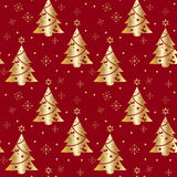 Festive background.Seamless pattern in gold color on a red background. Tree. Christmas and New year.Texture for web,print,Wallpaper,decoration,winter,fashion Royalty Free Stock Images
