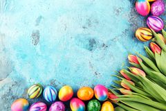 Festive background setting for Easter with eggs and tulips. Festive background setting for Easter with eggs and tulips Stock Image