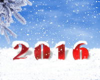 Festive background with snow in 2016. Red numbers 2016, powdered with snow Stock Image