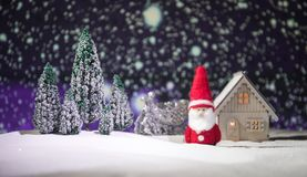 Festive background. snowman dressed as Santa Claus with Christmas balls on light background photo has an empty space for your text. Festive background. Christmas stock photos
