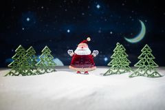 Festive background. snowman dressed as Santa Claus with Christmas balls on light background photo has an empty space for your text. Festive background. Christmas stock image
