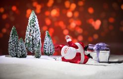 Festive background. snowman dressed as Santa Claus with Christmas balls on light background photo has an empty space for your text. Festive background. Christmas royalty free stock image