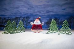 Festive background. snowman dressed as Santa Claus with Christmas balls on light background photo has an empty space for your text. Festive background. Christmas royalty free stock images