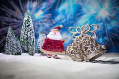 Festive background. snowman dressed as Santa Claus with Christmas balls on light background photo has an empty space for your text. Festive background. Christmas royalty free stock photos