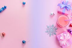 Festive background for text composition flat lay Christmas items gift box ribbon bow pink glass cocktail Christmas toys Top view c. Festive background for text stock photography