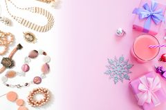 Festive background for text composition flat lay Christmas items gift box ribbon bow pink glass cocktail Christmas toys Top view c. Festive background for text stock images