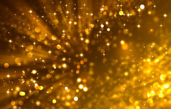 Glittery golden festive background with stars. Festive background with twinkle golden lights and stars Royalty Free Stock Image