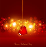 Festive background for Valentine's Day. With heart hanging on ribbon Royalty Free Stock Photography