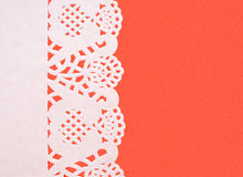 Festive background white paper doily on textured red background Royalty Free Stock Photo