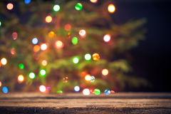 Festive background wooden table Christmas tree lights Stock Photo