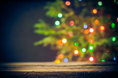 Festive background wooden table Christmas tree lights Royalty Free Stock Image