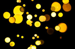 Festive background with yellow, orange, brown lights Stock Images