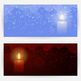 Festive backgrounds with candle lights. Two winter festive greeting cards in dark-red and blue colors, with candle lights, sparks and snowflakes. Horizontally Royalty Free Stock Photo