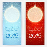 Festive backgrounds with Christmas balls. Set of two festive backgrounds in blue and red colours with decorative Christmas balls and greeting texts Royalty Free Stock Images
