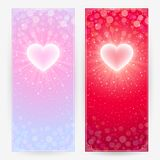 Festive backgrounds with hearts. Two festive backgrounds in light pink and bright red colors with lighting hearts. Vertical banners royalty free illustration
