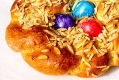 Festive bakery - Homemade Easter traditional bread. Homemade Easter traditional bread decorated with colorful eggs, festive bakery Royalty Free Stock Image