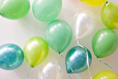 Festive balloons floating on the ceiling Royalty Free Stock Photos