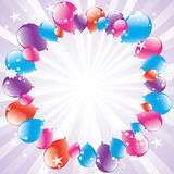 Festive balloons and light-burst Royalty Free Stock Image