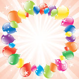 Festive balloons and light-burst Stock Image