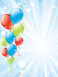 Festive balloons and lightburst Stock Images
