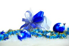 Festive balls with. Gift box on snow royalty free stock photos