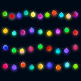 Festive balls for design. Glowing Christmas lights garland. Colorful matte sphere for design on black background Royalty Free Stock Photo